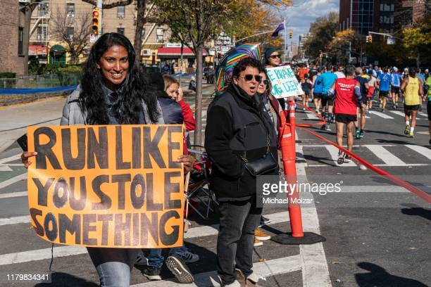 A fan showing a sign stating that runners should run like they have stolen something during 2019 TCS New York City Marathon in New York City on...
