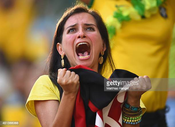 A fan shows her emotions as she watches the Brazil and Chile penalty shoot out on the big screen ahead of the 2014 FIFA World Cup Brazil round of 16...