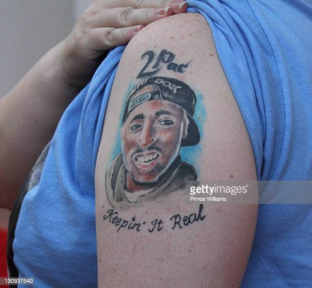 A fan shows her tattoo during Tupac's 40th Birthday Celebration at the Atlanta Symphony Hall on June 16 2011 in Atlanta Georgia