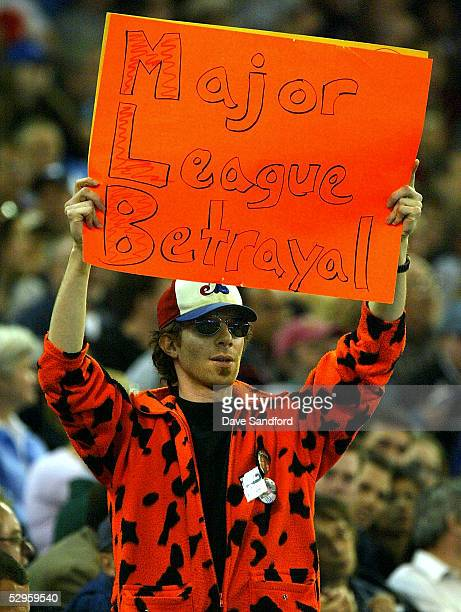 A fan shows his displeasure with the move of the Montreal Expos franchise to Washington Nationals as the Washington Nationals take on the Toronto...