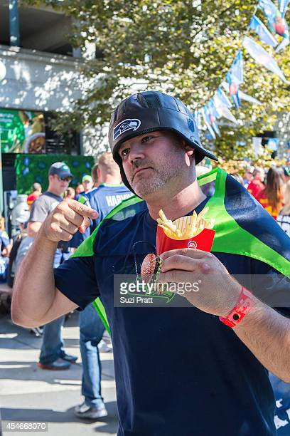 NFL fan shows his enthusiasm for tailgating at McDonald's season opener kickoff party aton September 4 2014 in Seattle Washington