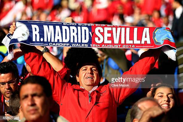A fan shows his support prior to kickoff during the UEFA Super Cup between Real Madrid and Sevilla FC at Cardiff City Stadium on August 12 2014 in...