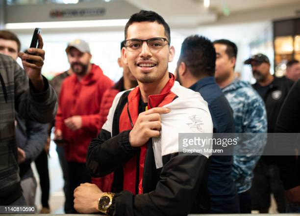 A fan shows of a his jacket signed by Robbie Lawler during the UFC Fight Night Open Workouts event at the Mall of America on May 2 2019 in...