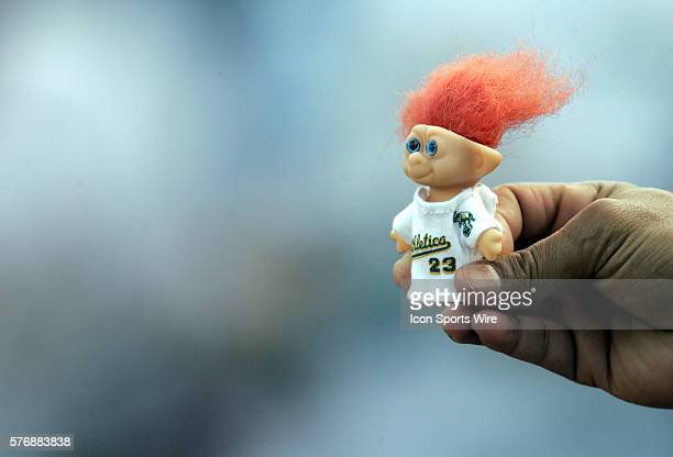 A fan shows off Athletics' Bobby Kielty Troll Doll before the game against the Rangers at McAfee Coliseum in Oakland California Texas Rangers...