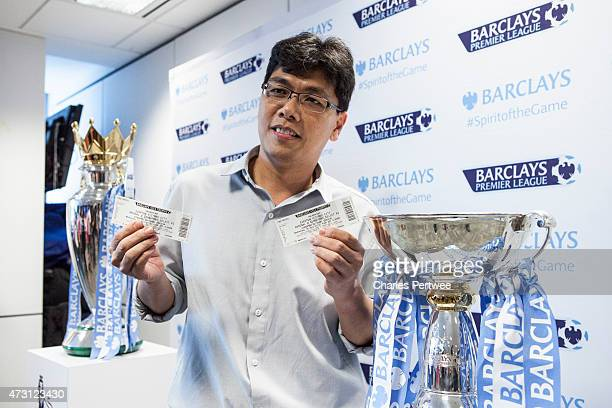 A fan shows one of the first tickets for the tournament during a QA at the Barclays office during the Barclays Asia Trophy 2015 Ticket Launch day 2...