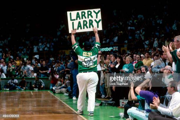 A fan shows support to Larry Bird of the Boston Celtics during a game played in 1992 at the Boston Garden in Boston Massachusetts NOTE TO USER User...