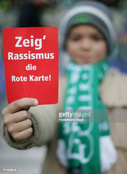 A fan shows the red card against racism prior to the Bundesliga match between Hanover 96 and VfL Wolfsburg at the AWD Arena on October 21 2007 in...