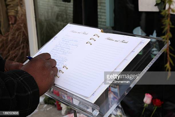 A fan signs the guest book at 'Whigham Funeral Home' for a private viewing Whitney Houston on February 17 2012 in Newark New Jersey Whitney Houston...