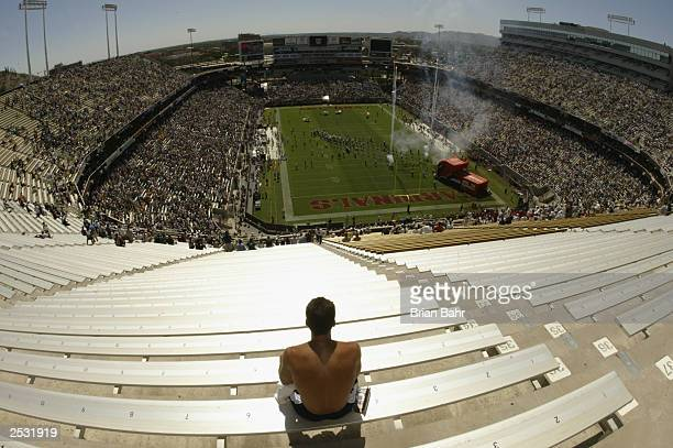 Fan sits by himself among empty bleachers before the start of a Green Bay Packers game against the Arizona Cardinals on September 21, 2003 at Sun...