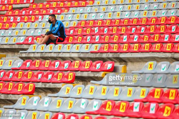 Fan sits in a bench at Corregidora Stadium prior the 16th round match between Queretaro and FC Juarez as part of the Torneo Guard1anes 2021 Liga MX...