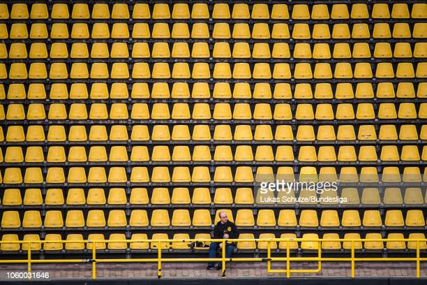Fan sits on the empty yellow tribune prior to the Bundesliga match between Borussia Dortmund and FC Bayern Muenchen at Signal Iduna Park on November...