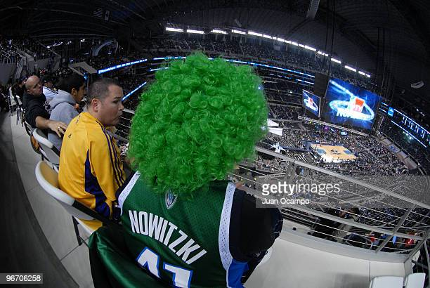 A fan sits wearing a Dirk Nowitzki jersey watches from the upper deck during the NBA AllStar Game as part of 2010 NBA AllStar Weekend on February 14...
