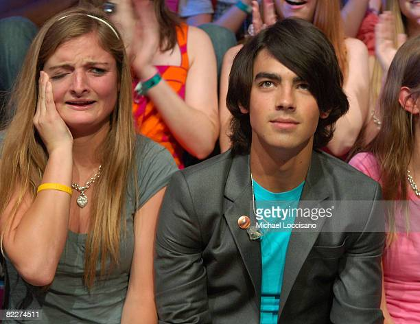 """Fan sits with musician Joe Jonas during MTV's """"TRL"""" at MTV studios on August 12, 2008 in New York City."""