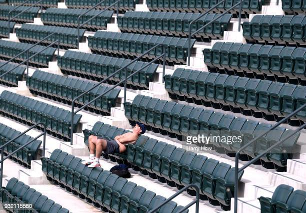 A fan sleeps in the grandstand during the BNP Paribas Open at the Indian Wells Tennis Garden on March 14 2018 in Indian Wells California