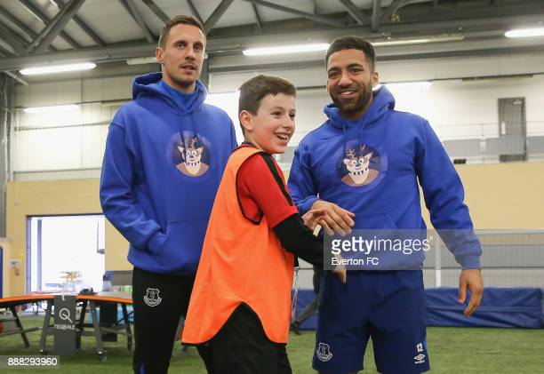 A fan speaks to Aaron Lennon of Everton and Phil Jagielka of Everton during the Coaching Session With a Junior Teamat at USM Finch Farm on December 5...