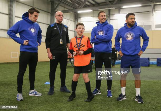 A fan speaks to Seamus Coleman of Everton Aaron Lennon of Everton and Phil Jagielka of Everton during the Coaching Session With a Junior Teamat at...