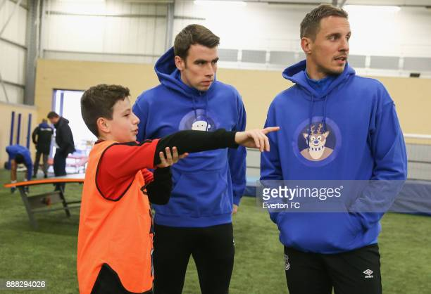 A fan speaks to Seamus Coleman of Everton and Phil Jagielka of Everton during the Coaching Session With a Junior Teamat at USM Finch Farm on December...