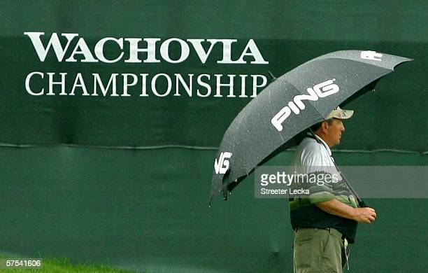 A fan stands alone during a rain delay in the second round of the Wachovia Championship at Quail Hollow Club on May 5 2006 in Charlotte North Carolina