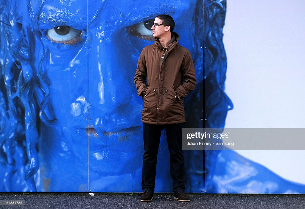 A fan stands by a large photo of David Luiz of Chelsea during the Barclays Premier League match between Chelsea and West Bromwich Albion at Stamford Bridge on November 9, 2013 in London, England.