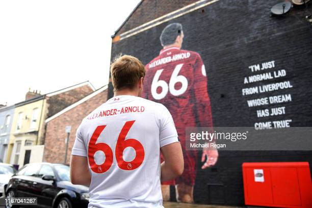 Fan stands in-front of mural of Trent Alexander-Arnold of Liverpool ahead of the Premier League match between Liverpool FC and Norwich City at...