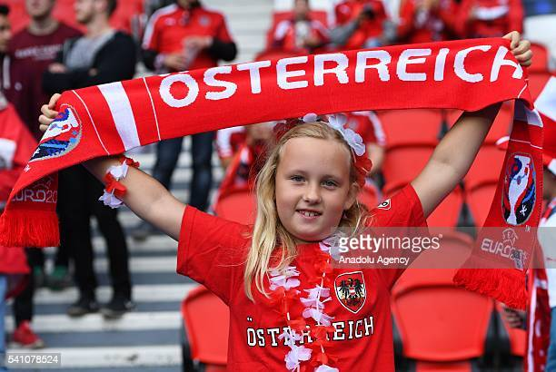 Fan supports her team during the EURO 2016 Group F football match between Portugal and Austria at the Parc des Princes in Paris, France on June 18,...