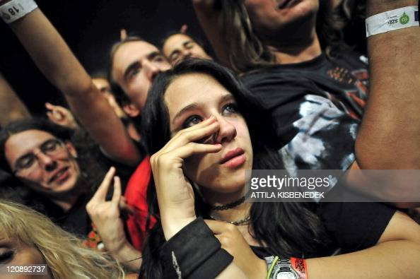 A Fan Sweeps Her Tears As British Heavy Metal Band From Birmingham News Photo