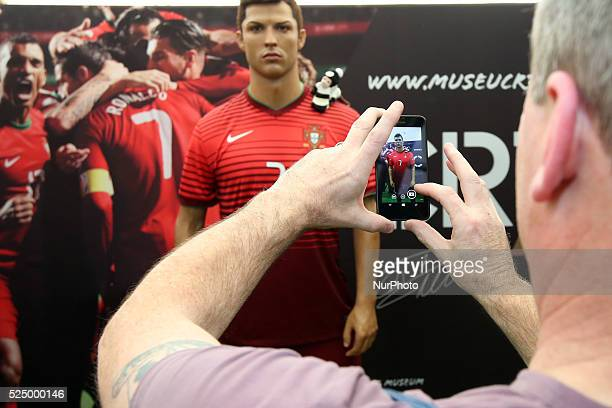 A fan take a picture of the Cristiano Ronaldo waxwork on display at the Cristiano Ronaldo traveling museum in Lisbon on October 6 2015