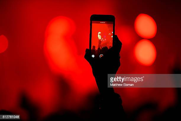 A fan takes a cell phone photo while R5 performs live on stage for the 'Sometime Last Night' Tour at the Beacon Theatre on February 27 2016 in New...