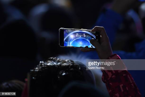 A fan takes a photo during the medal ceremonies on day five of the PyeongChang 2018 Winter Olympics at Medal Plaza on February 14 2018 in...