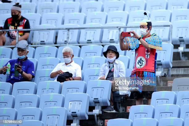 Fan takes a photo inside the stadium during the Women's First Round Group F match between China and Brazil during the Tokyo 2020 Olympic Games at...