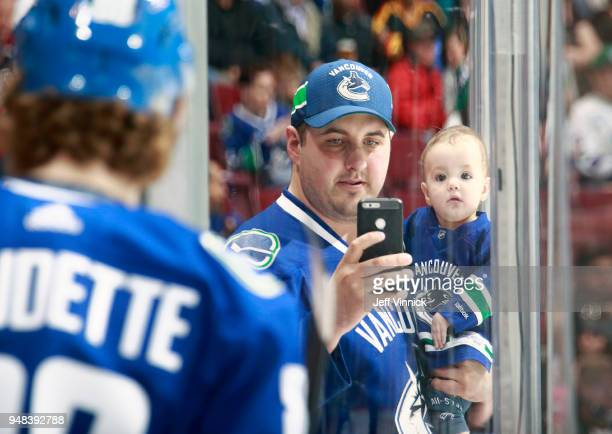 A fan takes a photo of Adam Gaudette of the Vancouver Canucks during their NHL game against the Columbus Blue Jackets at Rogers Arena March 31 2018...