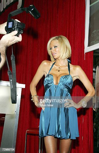A fan takes a photo of adult film actress Jenna Jameson at the Adult Video News Adult Entertainment Expo at the Sands Expo Center January 12 2007 in...