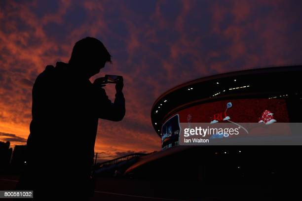 A fan takes a photo of the stadium after the FIFA Confederations Cup Russia 2017 Group A match between Mexico and Russia at Kazan Arena on June 24...