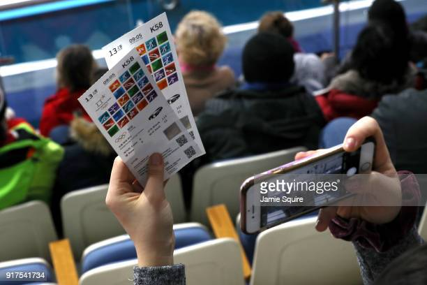 A fan takes a picture of her tickets during the Curling Mixed Doubles Bronze Medal Game between Olympic Athletes from Russia and Norway on day four...