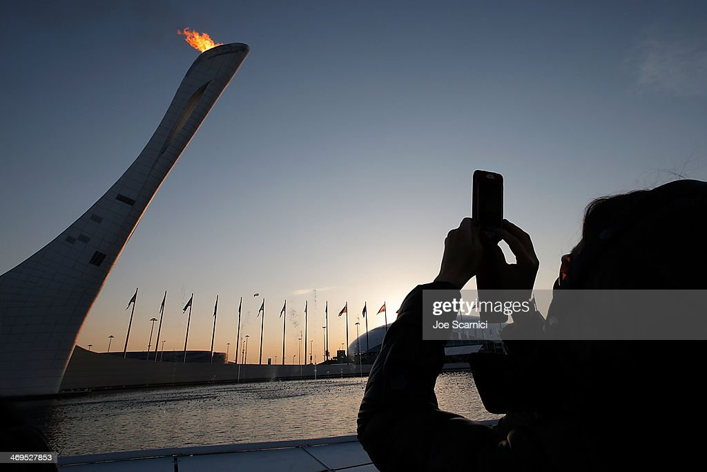 A fan takes a picture of the Olympic Cauldron at the Olympic Park during the Sochi 2014 Winter Olympics on February 15, 2014 in Sochi, Russia.