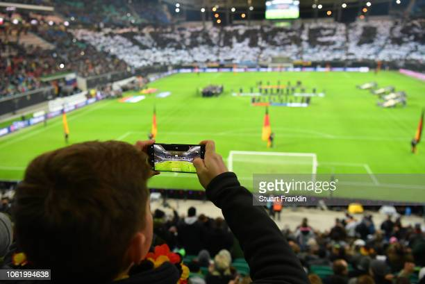A fan takes a picture prior to the International Friendly match between Germany and Russia at Red Bull Arena on November 15 2018 in Leipzig Germany