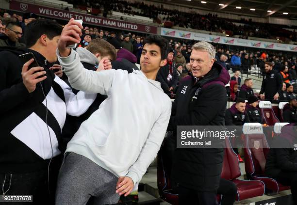 A fan takes a selfie photo with David Moyes manager of West Ham United during the Emirates FA Cup Third Round Replay match between West Ham United...