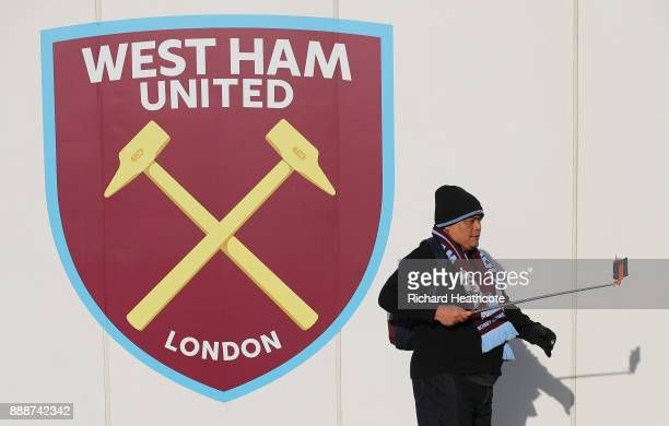 A fan takes a selfie photograph with the West Ham crest prior to he Premier League match between West Ham United and Chelsea at London Stadium on...