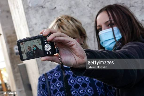 Fan takes a selfie with actress Maisie Williams, outside Chloe during Paris Fashion Week - Womenswear Spring Summer 2021, on October 01, 2020 in...