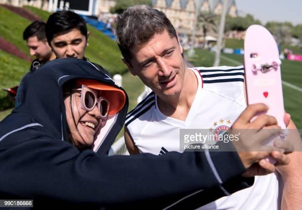 A fan takes a selfie with Bayern Munich's Robert Lewandowski after a training session in Doha Qatar 06 January 2018 Bayern Munich prepares for the...