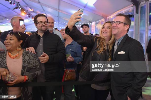 Fan takes a selfie with Chopped host Ted Allen at The Food Network & Cooking Channel New York City Wine & Food Festival Presented By Coca-Cola -...