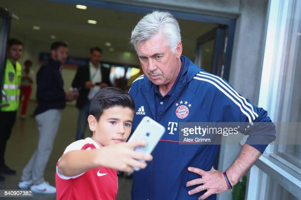 A fan takes a selfie with head coach Carlo Ancelotti of Muenchen during a friendly match between Kickers Offenbach and FC Bayern Muenchen at...