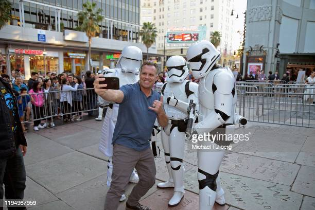 """Fan takes a selfie with Imperial stormtroopers at the IMAX opening of """"Star Wars: The Rise Of Skywalker"""" at TCL Chinese Theatre on December 19, 2019..."""