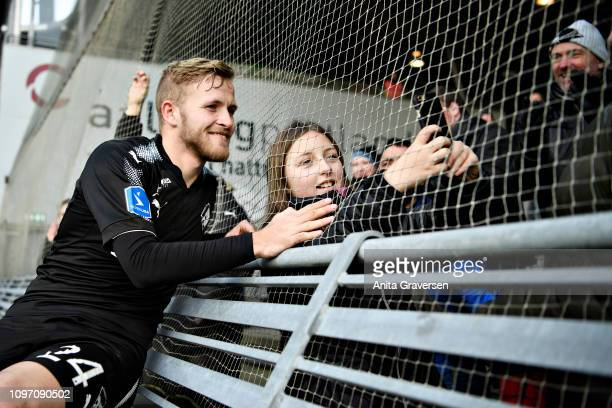 A fan takes a selfie with Jonas Bager of Randers FC after the Danish Superliga match between AaB Aalborg and Randers FC at Aalborg Portland Park on...
