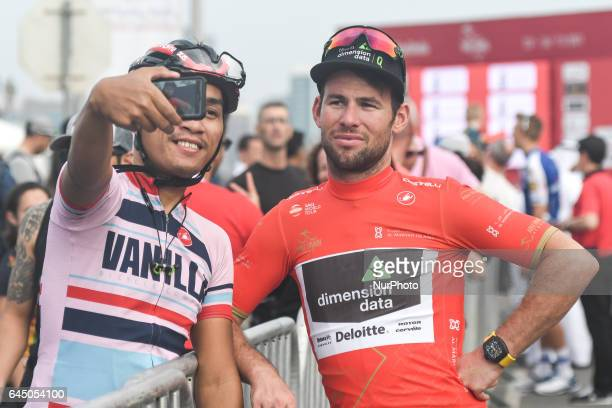 A fan takes a selfie with UK's Mark Cavendish from Dimension Data Team at the end of the second stage a 153 km Nation Towers stage from Abu Dhabi Al...