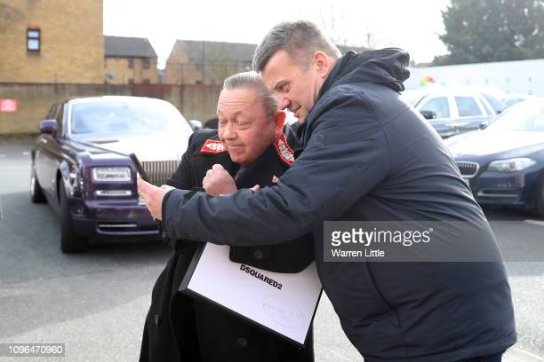 A fan takes a selfie with West Ham United coowner David Sullivan as he arrives at the stadium prior to the Premier League match between Crystal...