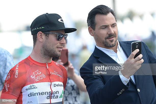 A fan takes a selfy with Mark Cavendish ahead of the start of the 2016 Tour of Dubai's second stage the 188km Nakheel Stage from DIMC going through...