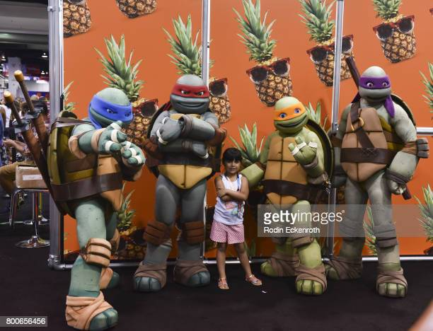 Fan takes picture with Teenage Mutant Ninja Turtles at 2017 VidCon at Anaheim Convention Center on June 24 2017 in Anaheim California