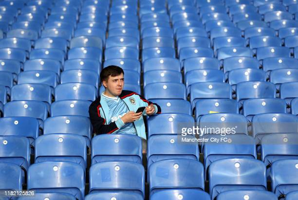 A fan takes their seat prior to the Premier League match between Crystal Palace and Manchester City at Selhurst Park on October 19 2019 in London...