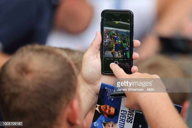 A fan taking a photo of Leighton Baines of Everton on their phone during the preseason friendly between Blackburn Rovers and Everton at Ewood Park on...